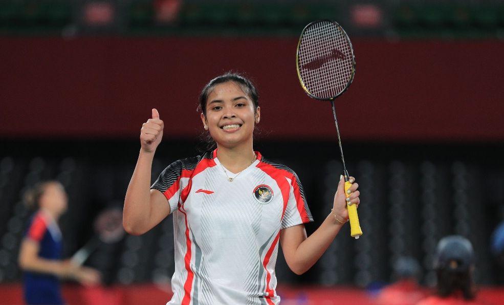 Gregoria Mariska Tunjung berpose usai kemenangan di laga terakhir Grup M Olimpiade Tokyo 2020, Rabu (28/7/2021).
